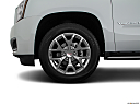 2019 GMC Yukon XL SLT, front drivers side wheel at profile.
