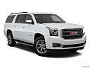2019 GMC Yukon XL SLT, front passenger 3/4 w/ wheels turned.