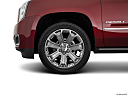 2019 GMC Yukon Denali, front drivers side wheel at profile.