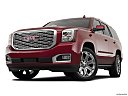 2019 GMC Yukon Denali, front angle view, low wide perspective.