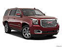 2019 GMC Yukon Denali, front passenger 3/4 w/ wheels turned.