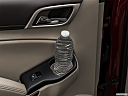 2019 GMC Yukon Denali, second row side cup holder with coffee prop, or second row door cup holder with water bottle.