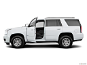 2019 GMC Yukon SLT, driver's side profile with drivers side door open.