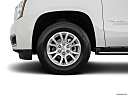 2019 GMC Yukon SLT, front drivers side wheel at profile.