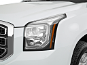 2019 GMC Yukon SLT, drivers side headlight.