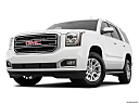 2019 GMC Yukon SLT, front angle view, low wide perspective.