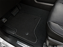 2019 GMC Yukon SLT, driver's floor mat and pedals. mid-seat level from outside looking in.