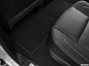 2019 GMC Yukon SLT, rear driver's side floor mat. mid-seat level from outside looking in.