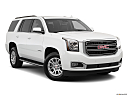 2019 GMC Yukon SLT, front passenger 3/4 w/ wheels turned.