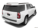 2019 GMC Yukon SLT, rear 3/4 angle view.