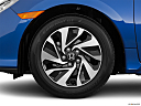 2019 Honda Civic Hatchback LX, front drivers side wheel at profile.