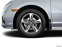 2019 Honda Odyssey Touring, front drivers side wheel at profile.