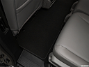 2019 Honda Odyssey Touring, rear driver's side floor mat. mid-seat level from outside looking in.