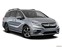 2019 Honda Odyssey Touring, front passenger 3/4 w/ wheels turned.