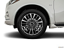 2019 Infiniti QX80 Luxe 4WD, front drivers side wheel at profile.