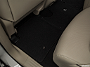 2019 Infiniti QX80 Luxe 4WD, rear driver's side floor mat. mid-seat level from outside looking in.