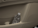 2019 Infiniti QX80 Luxe 4WD, second row side cup holder with coffee prop, or second row door cup holder with water bottle.
