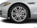 2019 Jaguar XE 25t Premium, front drivers side wheel at profile.