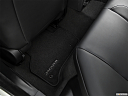 2019 Jaguar XE 25t Premium, rear driver's side floor mat. mid-seat level from outside looking in.