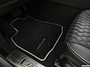 2019 Jaguar XJL Portfolio, driver's floor mat and pedals. mid-seat level from outside looking in.