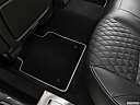 2019 Jaguar XJL Portfolio, rear driver's side floor mat. mid-seat level from outside looking in.