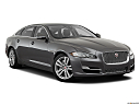 2019 Jaguar XJL Portfolio, front passenger 3/4 w/ wheels turned.