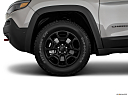 2019 Jeep Cherokee Trailhawk Elite, front drivers side wheel at profile.