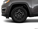 2019 Jeep Compass Sport, front drivers side wheel at profile.
