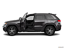 2019 Jeep Grand Cherokee Overland, driver's side profile with drivers side door open.