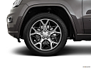 2019 Jeep Grand Cherokee Overland, front drivers side wheel at profile.