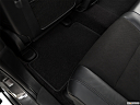 2019 Jeep Grand Cherokee Laredo E, rear driver's side floor mat. mid-seat level from outside looking in.