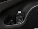 2019 Jeep Grand Cherokee Laredo E, second row side cup holder with coffee prop, or second row door cup holder with water bottle.