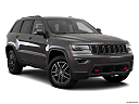 2019 Jeep Grand Cherokee Trailhawk, front passenger 3/4 w/ wheels turned.