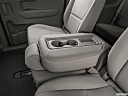 2019 Kia Sedona LX, rear center console with closed lid from driver's side looking down.