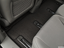 2019 Kia Sedona LX, rear driver's side floor mat. mid-seat level from outside looking in.