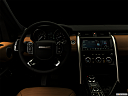 "2019 Land Rover Discovery HSE Luxury, centered wide dash shot - ""night"" shot."
