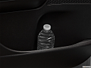 2019 Land Rover Discovery HSE Luxury, second row side cup holder with coffee prop, or second row door cup holder with water bottle.