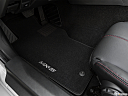 2019 Mazda MX-5 Miata Grand Touring, driver's floor mat and pedals. mid-seat level from outside looking in.