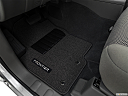 2019 Nissan Frontier SV, driver's floor mat and pedals. mid-seat level from outside looking in.