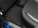2019 Nissan Kicks SV, rear driver's side floor mat. mid-seat level from outside looking in.