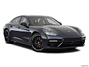 2019 Porsche Panamera Turbo, front passenger 3/4 w/ wheels turned.