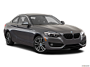 2020 BMW 2-series 230i, front passenger 3/4 w/ wheels turned.