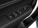 2020 BMW 2-series M240i, driver's side inside window controls.