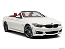 2020 BMW 4-series 440i Convertible, front passenger 3/4 w/ wheels turned.