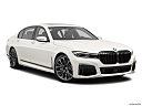 2020 BMW 7-series 750i xDrive, front passenger 3/4 w/ wheels turned.