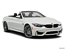 2020 BMW 4-series M4, front passenger 3/4 w/ wheels turned.