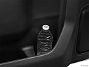 2020 Chevrolet Silverado 2500HD LT, second row side cup holder with coffee prop, or second row door cup holder with water bottle.