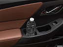 2020 Chevrolet Traverse High Country, second row side cup holder with coffee prop, or second row door cup holder with water bottle.