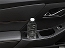 2020 Chevrolet Traverse RS, second row side cup holder with coffee prop, or second row door cup holder with water bottle.