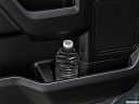 2020 Ford F-150 XLT, second row side cup holder with coffee prop, or second row door cup holder with water bottle.